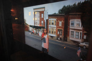 reflection-of-north-troy-slide-show-in-window-of-ntphm